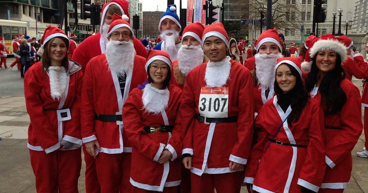 Scott Rees employees running in Santa Dash in Liverpool in 2013
