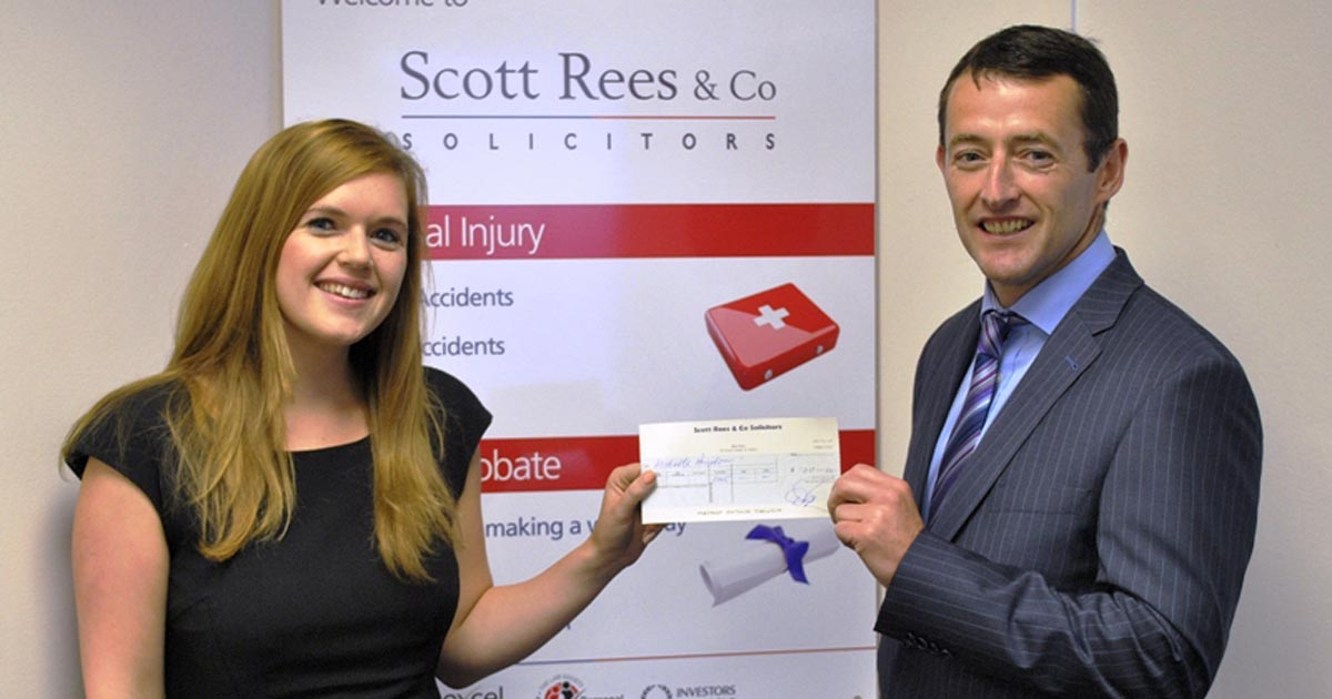 Michelle Aindow presented with cheque from David Byrne