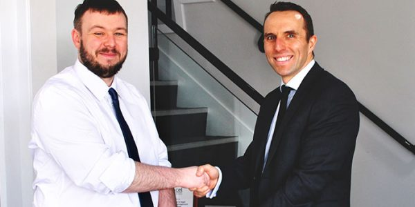 Chris Connor (right) hands Steven Gregory-Payne his Commendation Award in April 2018 at Scott Rees & Co