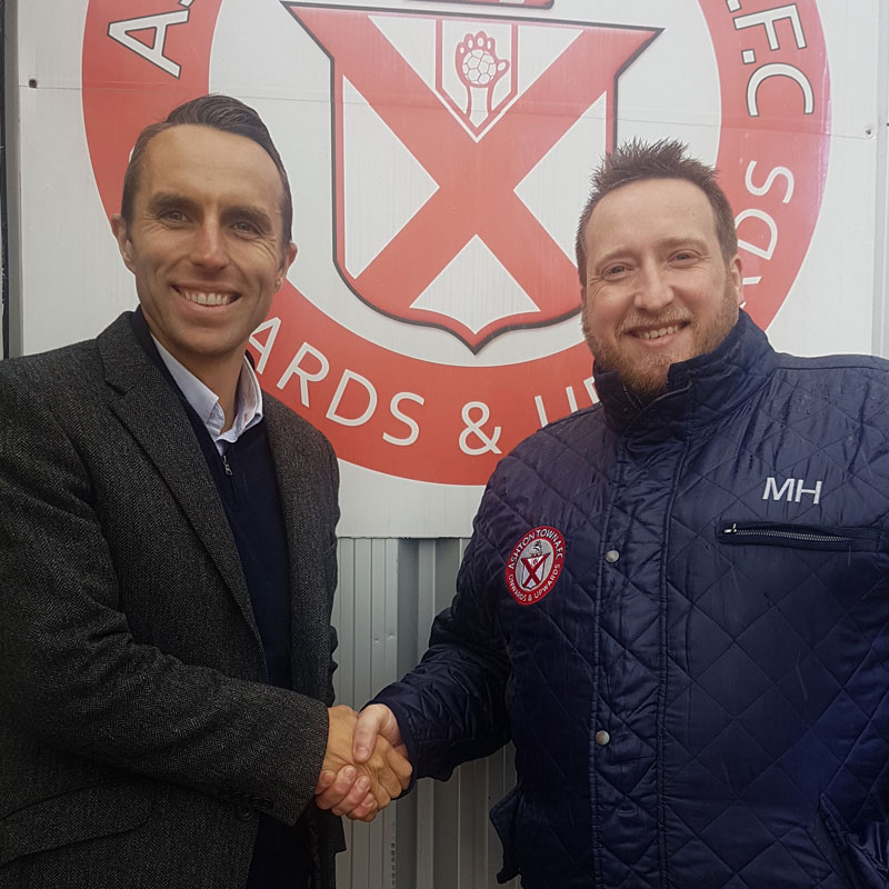 Chris Connor of Scott Rees & Co and Mark Hayes of Ashton Town AFC celebrating our partnership in 2019