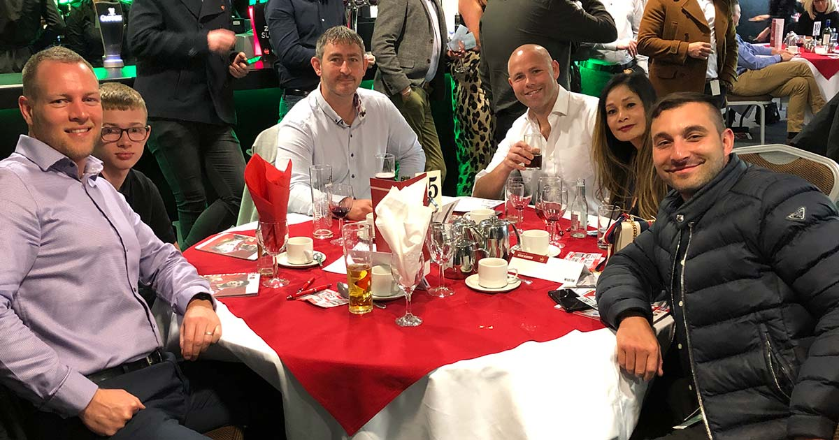 Stephen Hussey of Scott Rees & Co with Iain Routh and some of his staff from CompiClaims to watch Wigan Warriors vs Castleford Tigers in April 2019