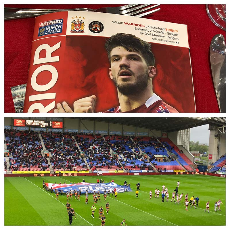 Wigan Warriors Official Programme and a photo of the DW Stadium before Wigan Warriors take on Castleford Tigers