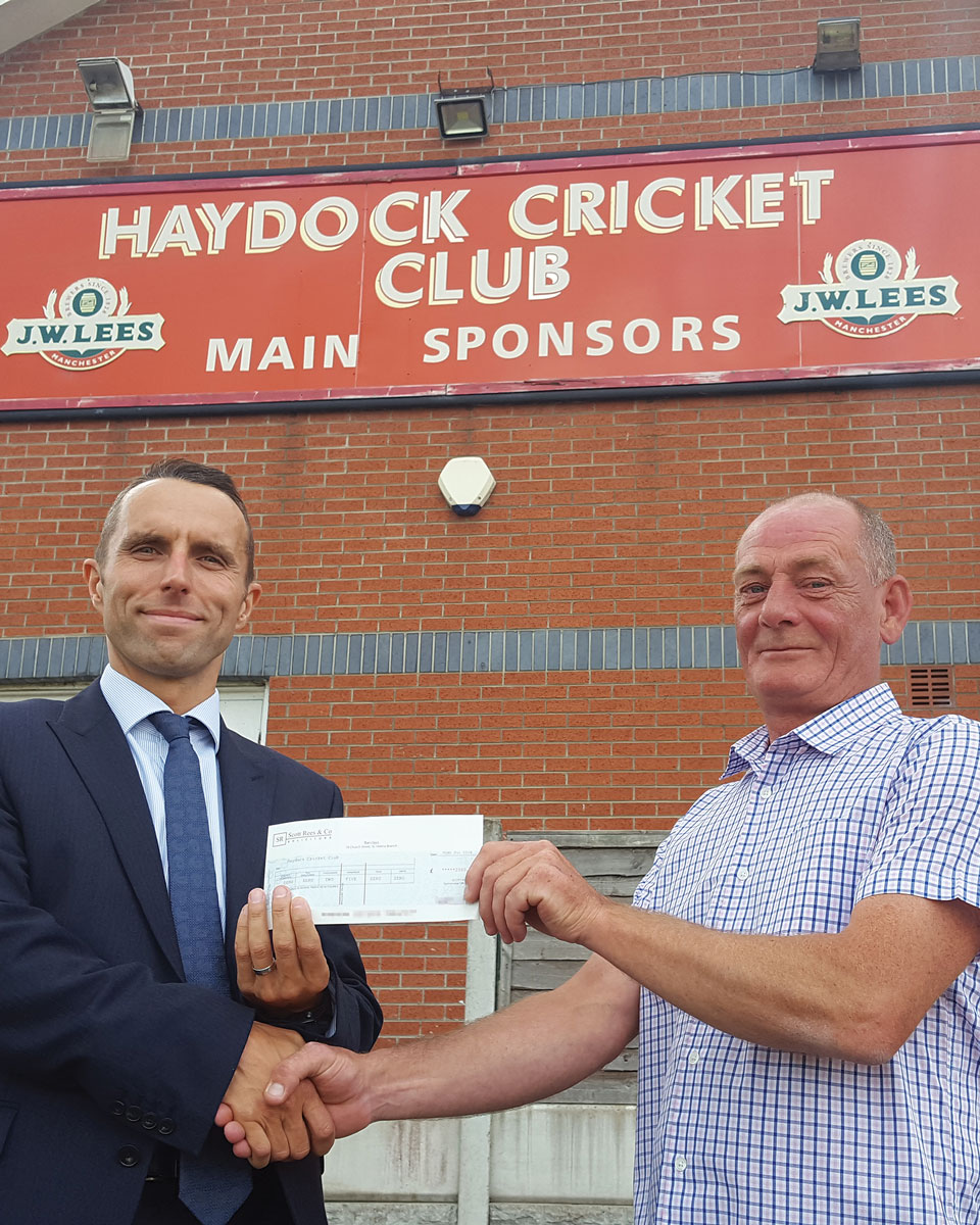 Chris Connor of Scott Rees giving sponsorship cheque to Dave Cross of Haydock Cricket Club